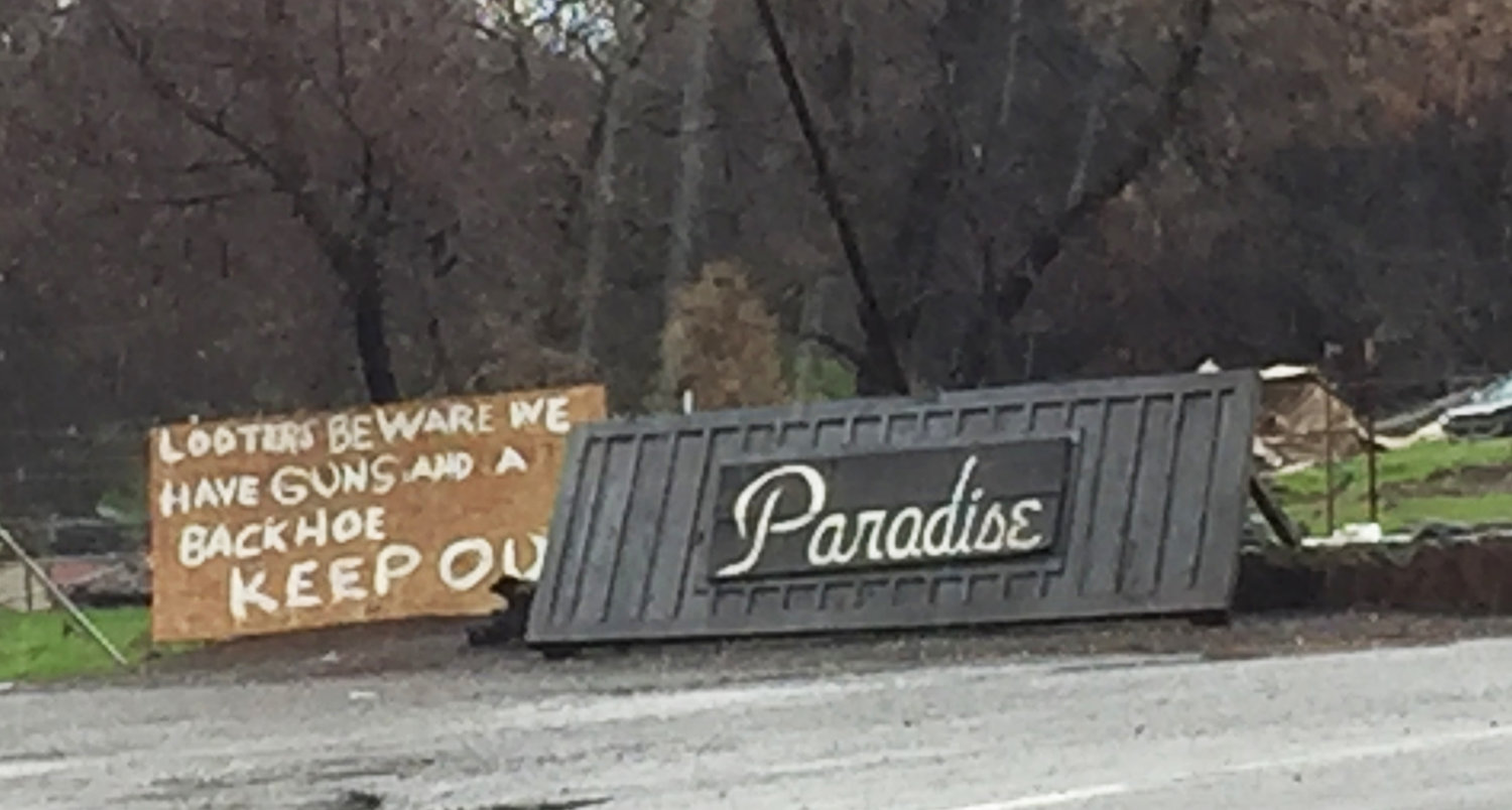 The welcome sign to Paradise now includes a warning to looters.