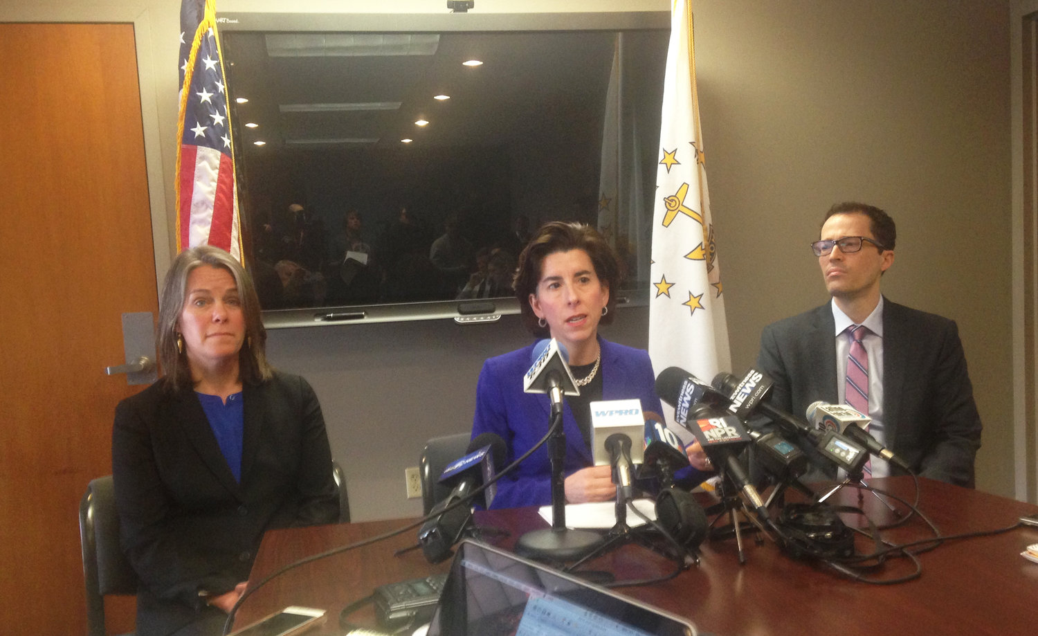 At a Feb. 15, 2017, news conference, Gov. Gina Raimondo, center, announces the resignation of Elizabeth Roberts as secretary of R.I. EOHHS and the demotion of EOHHS deputy director Jennifer Wood, and the appointment of Anya Rader Wallack, left, as acting secretary at EOHHS. At right is Eric Beane, who was eventually appointed as secretary at EOHHS.