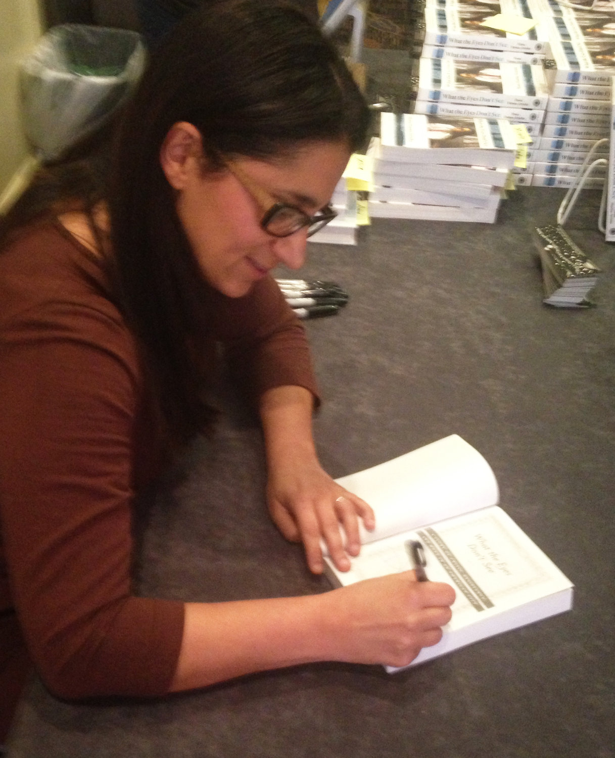 Dr. Mona Hanna Attisha signing her book, What the Eyes Don't See, following a talk last week in Rhode Island.