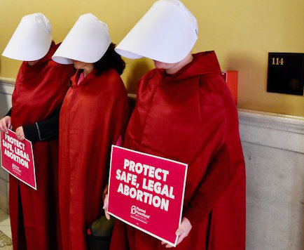 Handmaidens at the R.I. General Assembly on May 14.