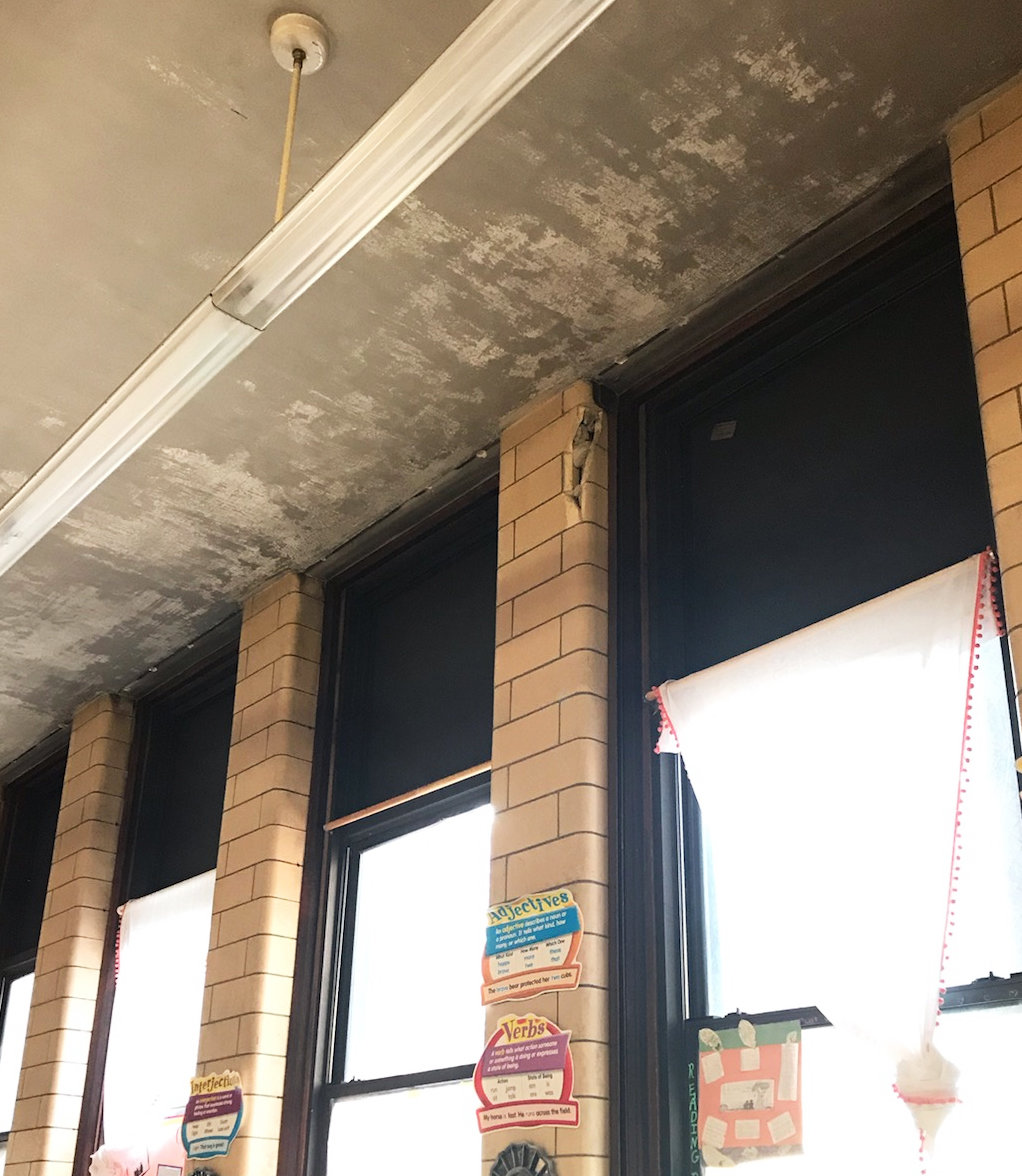 The ceilings in Betsy Taylor's classroom in the basement of Hope High School appeared to be discolored and flaking.