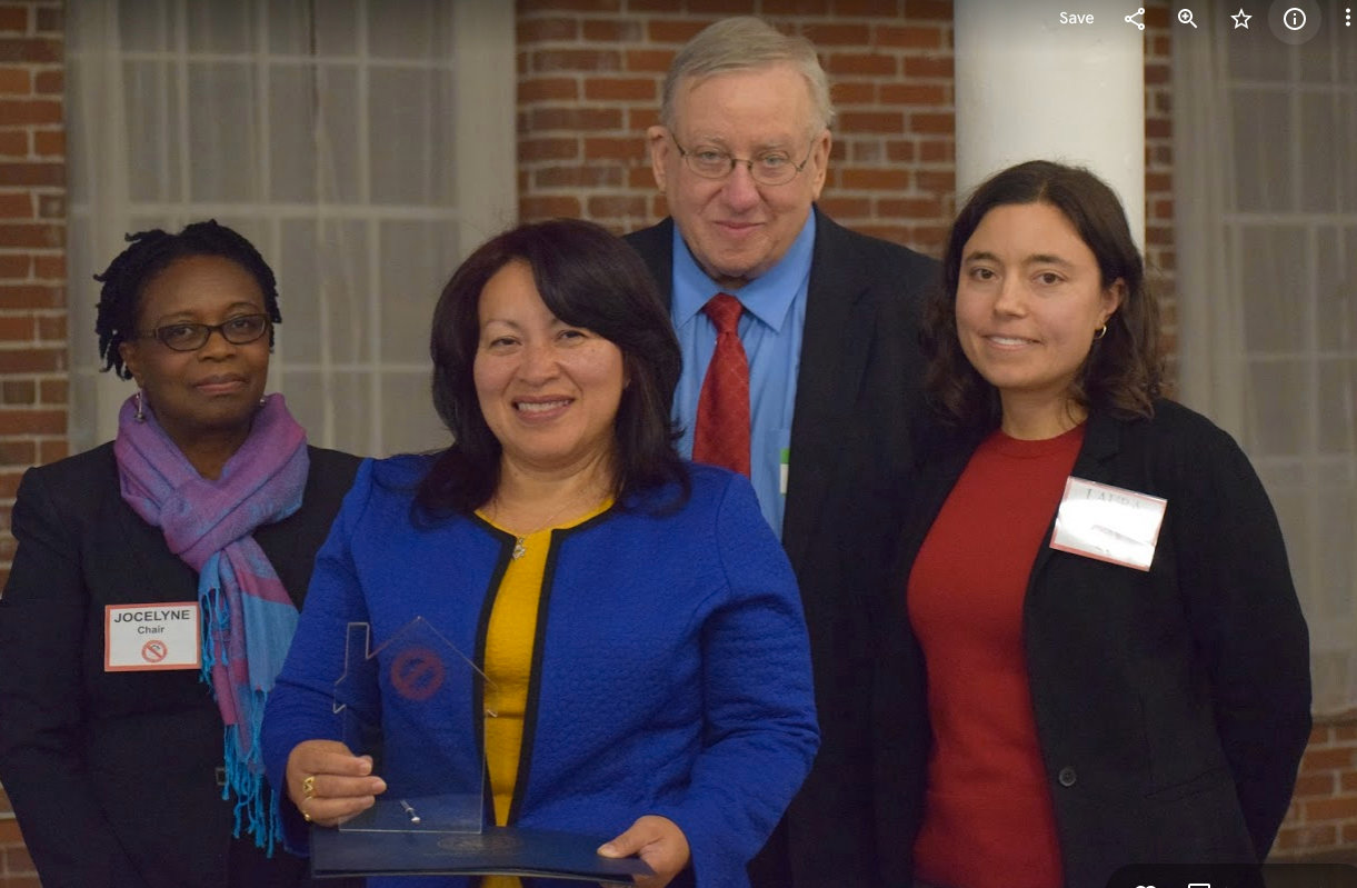 At the Nov. 14 Childhood Lead Action Project celebration. From left,  CLAP Board Chair Jocelyne de Gouvernain, award winners Maria Betancur and Richard Asinof, and Laura Brion, executive director of CLAP.
