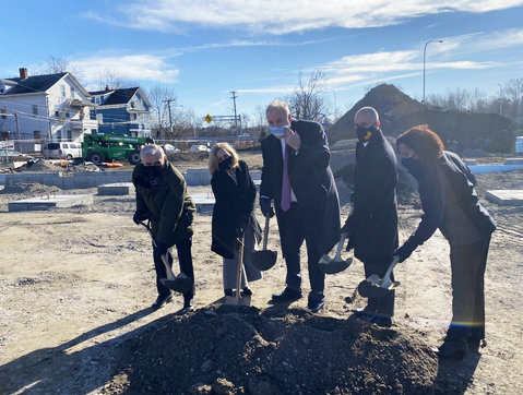 A new community health facility grows in Olneyville. From left: Sen, Jack Reed, PCHC Board Chair Elena Nicolella, PCHC President and CEO Merrill Thomas, Providence Mayor Jorge Elorza, and Providence City Council President Sabina Matos, at the ceremonial groundbreaking on Friday, Jan. 8,