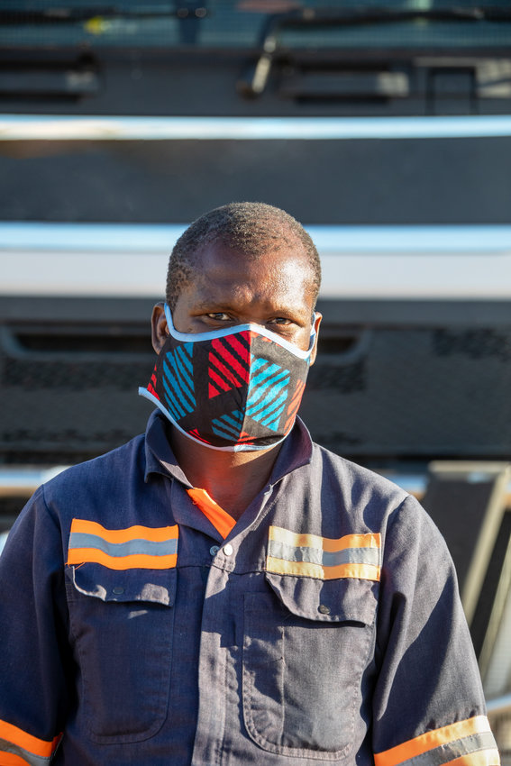 African truck driver wearing a face mask to avoid contamination