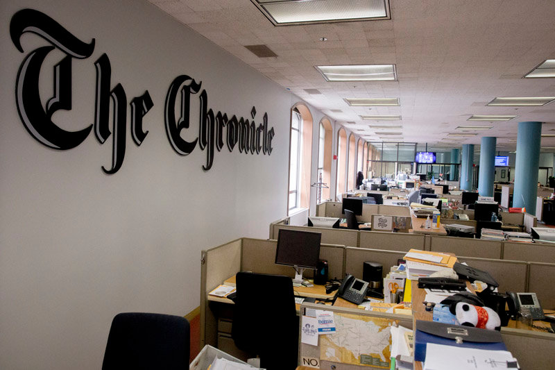 Desks sit empty in the San Francisco Chronicle newsroom on Mission Street in San Francisco, Calif. Saturday, March 14, 2020. For the first time in the newspaper's 155-year history, its editorial staff made the decision to place a mandatory work from home policy on newsroom staff amid the Coronavirus threat.