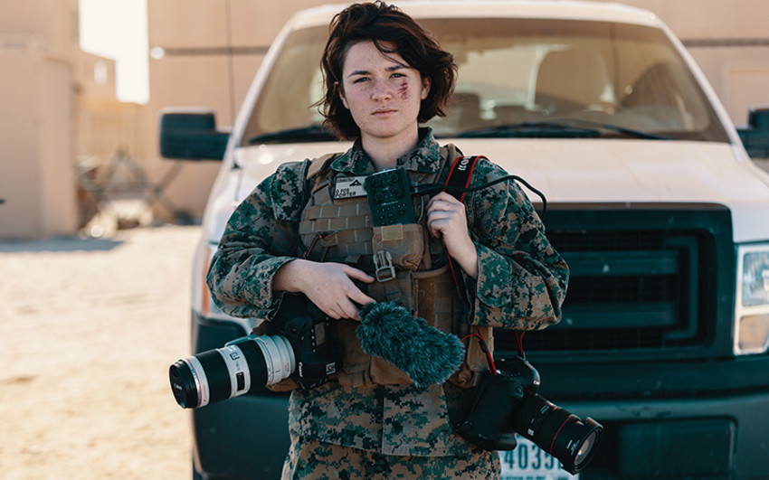 U.S. Marine Corps Lance Corporal Rachel Young, combat photographer, Communications Strategy and Operations, Marine Air Ground Task Force Training Command, Marine Corps Air Ground Combat Center, poses for a portrait during Integrated Training Exercise (ITX) in Twentynine Palms, Calif. (U.S. Marine Corps photo by Lance Corporal Robin Lewis)