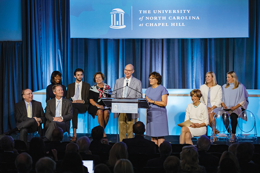 Walter Hussman Jr. (center) addresses the crowd at a celebration for the opening of the Hussman School of Journalism and Media. (Photo provided)