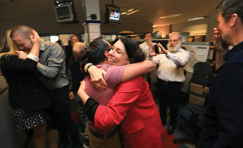Executive editor Catherine Barnett embraces reporter Martin Espinoza after the Press Democrat won the Pulitzer Prize for Breaking News Reporting in April 2018. At left, reporters JD Morris and Christi Warren celebrate along with director of photography Chad Surmick, middle left, with city editors Brett Wilkison and Steve Levin, middle right, and reporter Kevin McCallum. (Photo by Kent Porter/Press Democrat)
