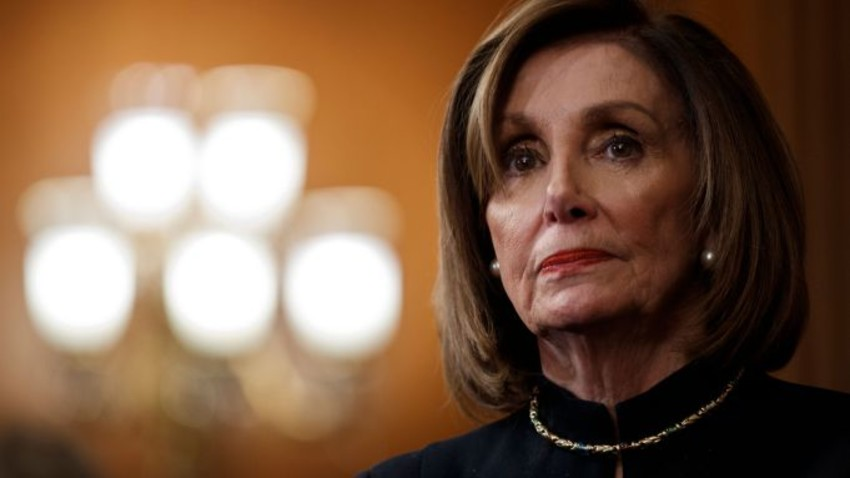 Mandatory Credit: Photo by SHAWN THEW/EPA-EFE/Shutterstock (10509243ap) Speaker of the House Nancy Pelosi looks on during a press conference following the impeachment vote of US President Donald J. Trump at the US Capitol in Washington, DC, USA, 18 December 2019. Donald Trump is the third president in US History to be impeached. The House will not immediately send the articles of impeachment to the Senate, where a trial is expected early in 2020. House Speaker Nancy Pelosi holds press conference after Trump's impeachment, Washington, USA - 18 Dec 2019