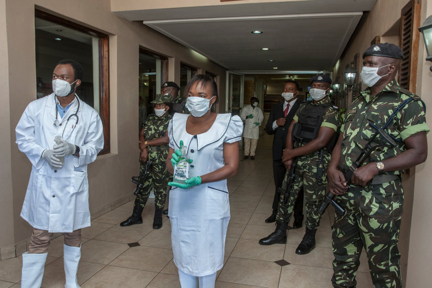 Blantyre District Health Office Medical Staff and armed policemen wear face masks to as a preventive measure against the spread of the COVID-19 coronavirus as they wait for delegates at Mount Soche hotel in Blantyre on May 6, 2020, where Malawi's two main opposition figures presented nomination papers for a July re-run of presidential polls that saw the re-election of President Peter Mutharika last May. (Photo by AMOS GUMULIRA / AFP)