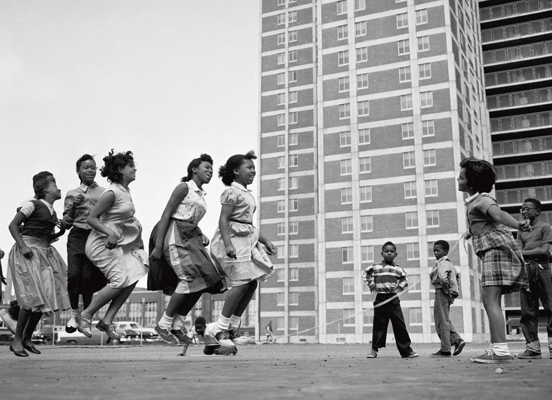 Children jumping rope on the playground of Cabrini-Green housing project, Chicago, Illinois.
