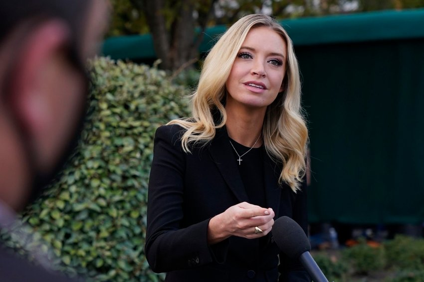 White House press secretary Kayleigh McEnany, talks to the media, Sunday, Oct. 4, 2020, outside the White House in Washington. (AP Photo/Jacquelyn Martin)