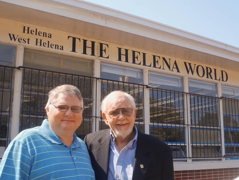 Andrew Bagley (left) and Chuck Davis stand outside the office of the Helena World.