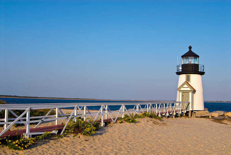 Walkway leads to Brant Point lighthouse, a famous beacon on Nantucket Island in Massachusetts.