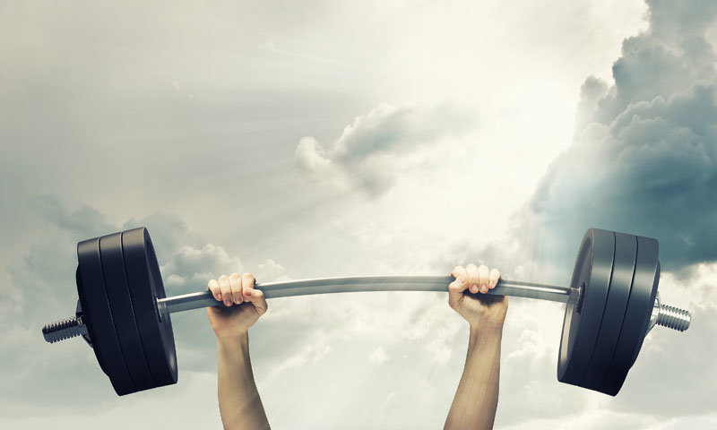 Lifting barbell above head. Strength and power