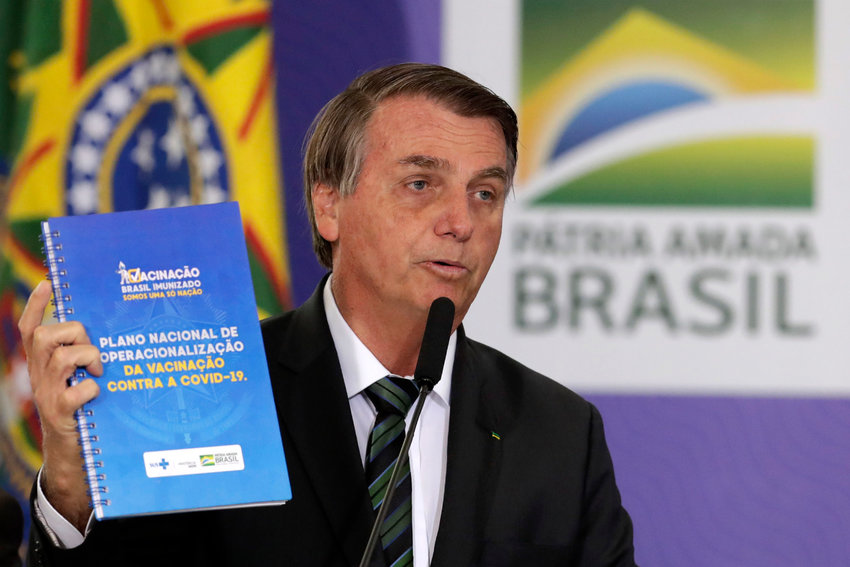 Brazilian President Jair Bolsonaro presents his nation's National Vaccination Plan Against COVID-19, at the Planalto presidential palace in Brasilia, Brazil, Wednesday, Dec. 16, 2020. (AP Photo/Eraldo Peres)