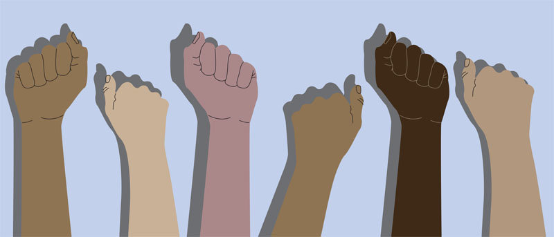 Human hands with clenched fists. Protest, stop racism, equality concept. Fight for your rights. People of different nationalities and races raise up fists.