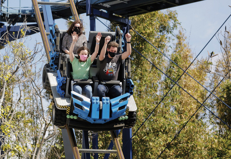 Michelle Donar and her brother Curtis Donar ride the Technic Coaster ride at Legoland California Resort in Carlsbad, Calif. during the reopening of the park April 1, 2021 after its approximate one-year closing due to COVID-19.