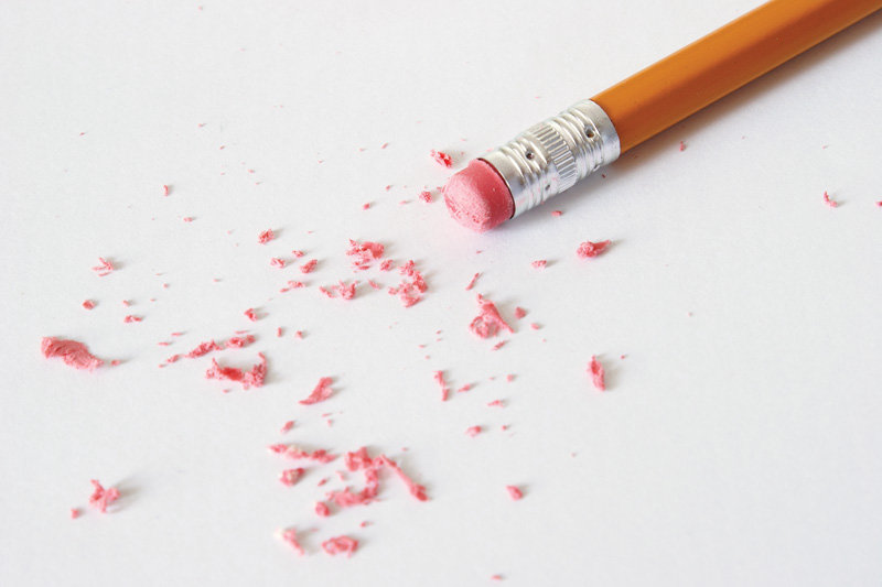 A pencil is making corrections by erasing the mistakes.