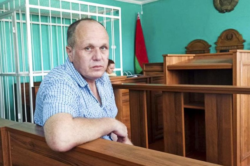 """This undated photo provided by Belarusian Human Rights Center """"Viasna,"""" shows Belarusian journalist Siarhei Hardziyevich sitting in a court room in Minsk, Belarus. A court in Belarus has convicted Siarhei Hardziyevich of insulting the president in messages in a deleted chat group and sentenced him to 1 1/2 years in prison, the Belarusian Association of Journalists says. (Human Rights Center Viasna via AP)"""