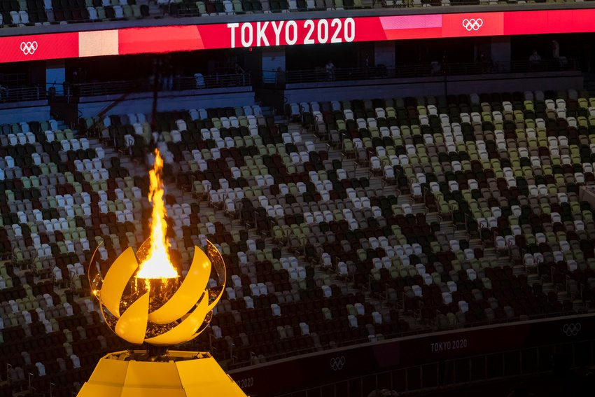The Olympic cauldron is lit during the opening ceremony of the Tokyo Olympics on Friday, July 23, 2021 at Olympic Stadium. (Brian Cassella/Chicago Tribune)