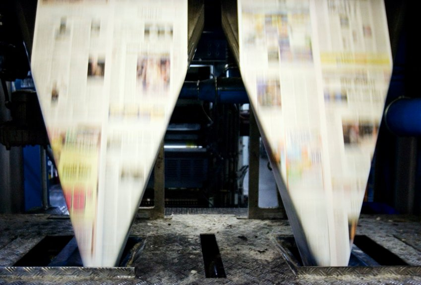 Newspapers enter the folder after being printed at the Colorweb press. (Photo by Liz Martin/The Gazette)