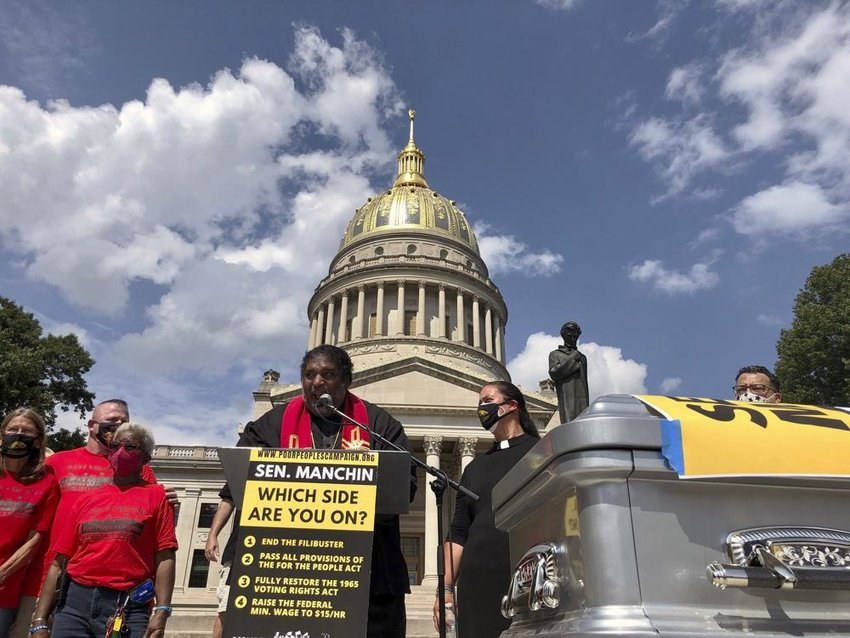 The Rev. William Barber, co-chair of the Poor People's Campaign, speaks during a rally Thursday, Aug. 26, 2021, at the state Capitol in Charleston, W.Va. The rally was aimed at applying pressure on U.S. Sen. Joe Manchin, who has opposed a sweeping overhaul of U.S. election law and a $15 federal minimum wage. (Photo by John Raby / AP)