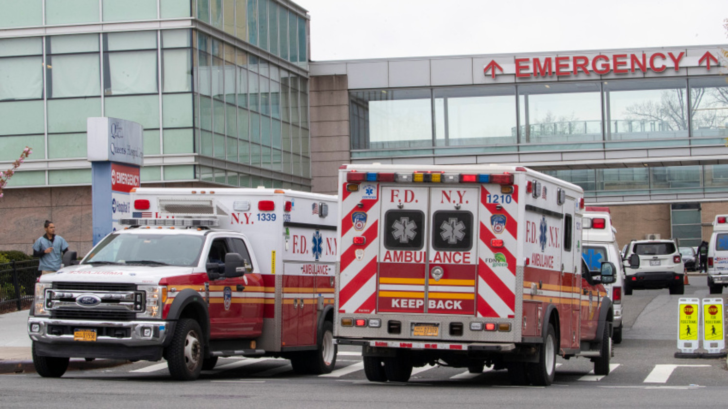FDNY ambulances are seen entering and leaving the emergency room at Queens Hospital Center, Monday, April 20, 2020, in the Jamaica neighborhood of the Queens borough of New York. The new coronavirus causes mild or moderate symptoms for most people, but for some, especially older adults and people with existing health problems, it can cause more severe illness or death. (AP Photo/Mary Altaffer)