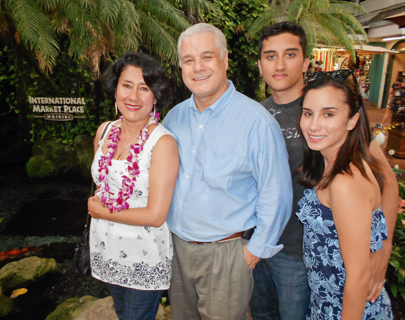 Robert Bard pictured with his wife Lupita Colmenero, son Marcos Suarez and daughter Eileen Suarez.