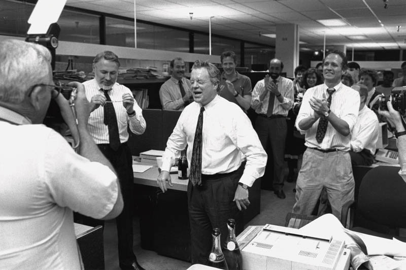 Seattle Times publisher Frank Blethen (center) is doused with champagne as the newsroom celebrates its Pulitzer Prize for National Reporting in 1990 for its coverage of the Exxon Valdez oil spill and its aftermath.