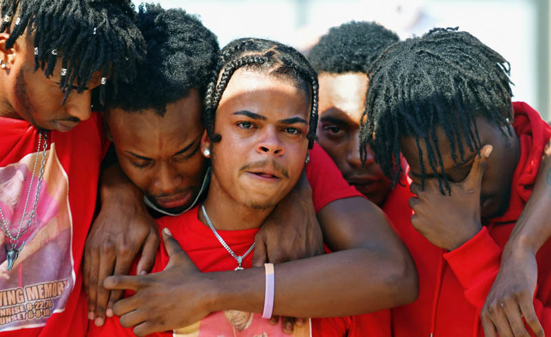 Shaheen Mackey Jr. (center) is consoled by friends during a rally, which took place on Aug. 9, 2020, in support of his father Shaheen Mackey, a Luzerne County Correctional Facility inmate who died after being restrained by corrections officers in 2018. Attendees began by marching from the Luzerne County Correctional Facility to the Luzerne County Courthouse where Black Lives Matter activists made their plea for justice in the case of Mackey's death.