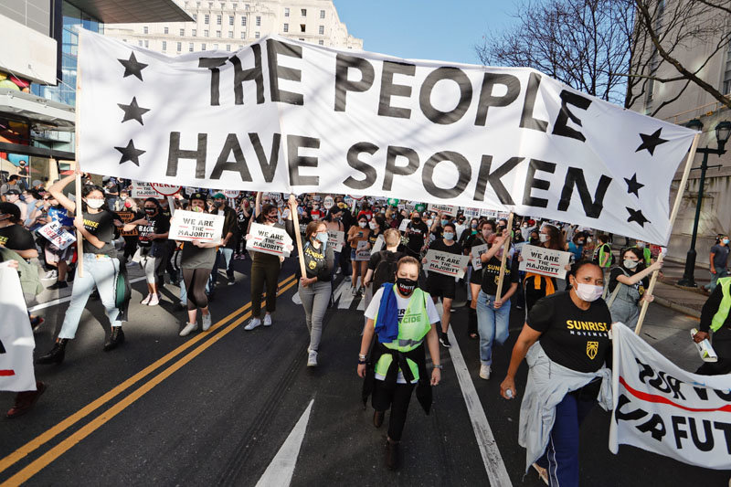 People take to the streets on the day the Associated Press and television networks projected that Joe Biden and Kamala Harris won Pennsylvania in the 2020 presidential election in Philadelphia on Nov. 7, 2020.