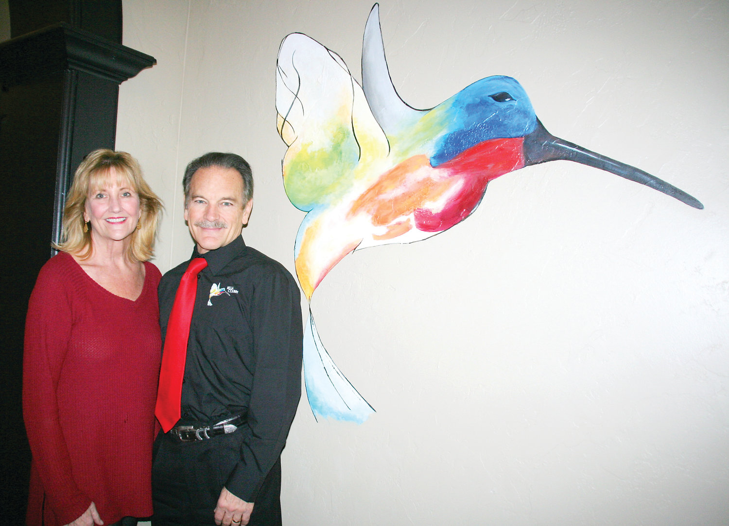 Aimee and Dean Valdez stand in the entryway of their new restaurant, Bella Colibri. The name in Italian means beautiful hummingbird. The hummingbird in the entryway was painted by Golden artist Alyssa Graves..
