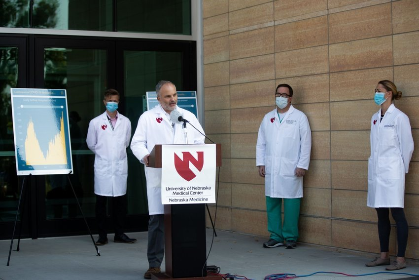 """UNMC's Dr. James Lawler, front, Dr. John Lowe, left, Dr. Daniel Johnson and Dr. Jana Broadhurst. Lawler said Nebraska's current coronavirus conditions do not call for schools to open fully and community activities to continue as normal. """"What we are seeing is a complete lack of personal responsibility."""""""