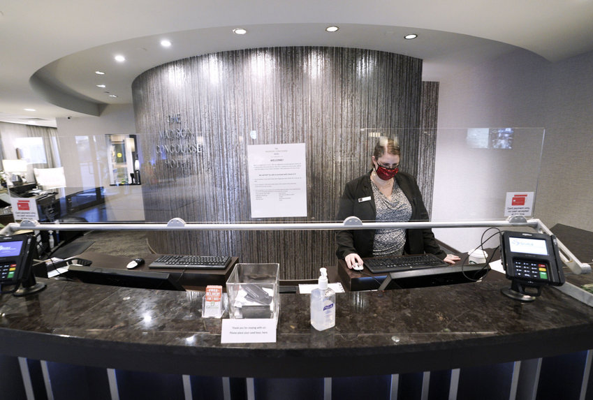 Amy Wasney, a front-desk agent at the Concourse Hotel, has had little business since March. Bookings at the hotel are down over 70% and the staff has been reduced from 260 to about 40 people.