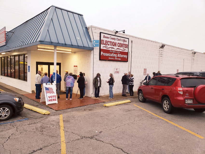 James L. White/StaffAbout 20 people were already standing in line to vote early Monday at the Boone County Election Center before it even opened.