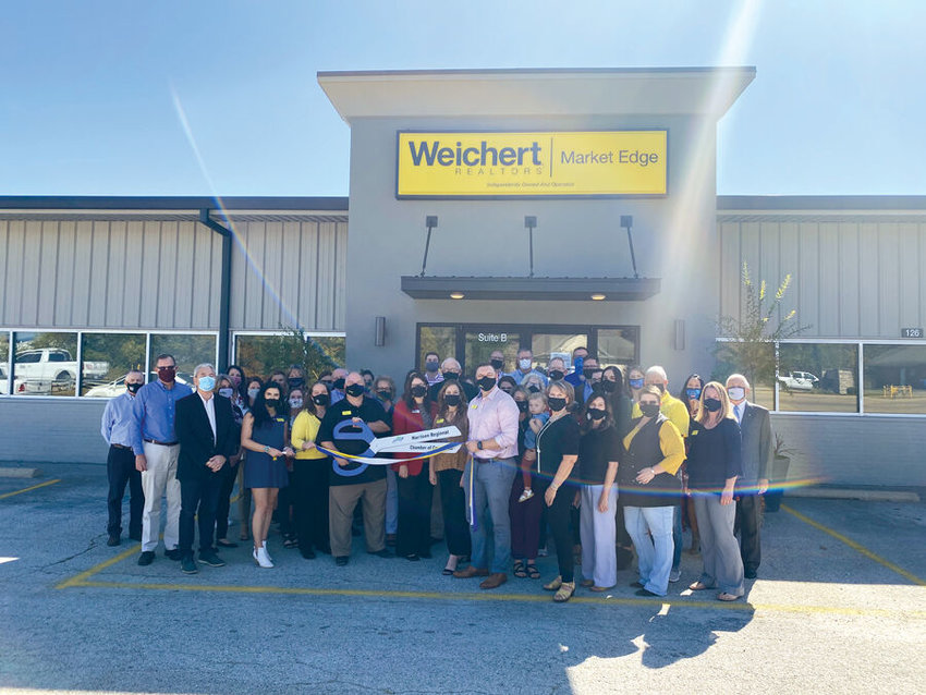 Donna Braymer/Staff Weichert, Realtors-Market Edge hosted a ribbon cutting with the Harrison Regional Chamber of Commerce on Tuesday, Oct. 13. Weichert owners, Melissa Collins, Franklin Harp and Travis Arnold purchased the 8,000 square foot building in November 2019 and watched it transform into a beautiful facility for 13 Real Estate agents. The new location is located at 126 Industrial Park Road and the number is (870) 743-5555.