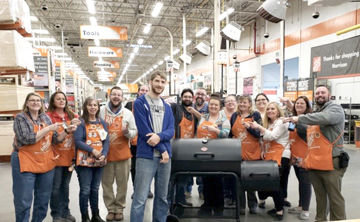 Contributed photoThe Home Depot gave away aChar-Griller Smokin' ChampCharcoal Grill/Smoker. It retails for $199 and is made with heavy duty construction so it's built to last. Jon Dezort was very excited and surprised that the entire leadership team came out to congratulate him on winning the drawing.