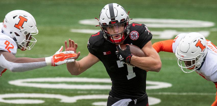 Nebraska quarterback Luke McCaffrey splits two Illinois defenders on a run Nov. 21, 2020, at Memorial Stadium.