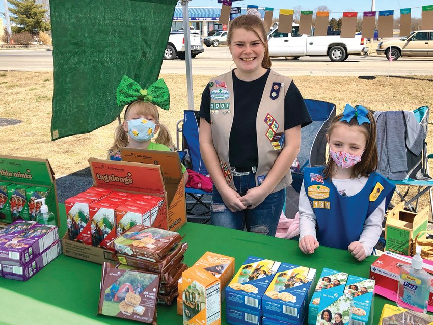 Girl Scout Daisies Jaelynn and Lydia, along with their mentor Senior, Lexi, sold cookies last weekend at a drive-through booth at Ace Hardware.