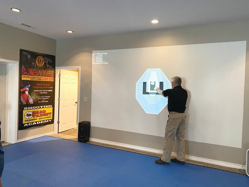 5.8 Hard Target Sites w/Troy  Donna Braymer/Staff    The MILO Shooting Simulator uses a wall to project targets so students can practice their shooting with a laser gun. Real-life scenarios can be played on the wall to teach students what to do in dangerous, life-threatening situations.