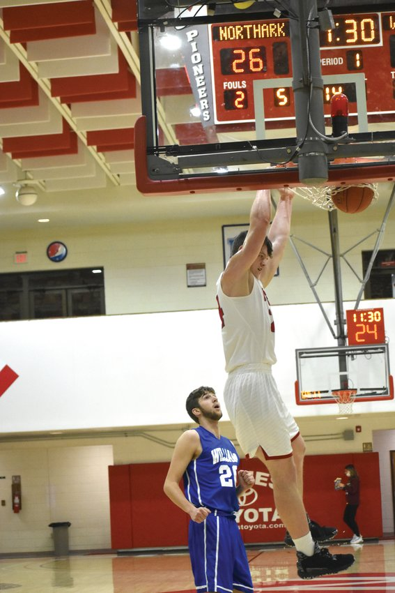 Sophomore Trent Lippoldt of North Arkansas College dunks the basketball at Pioneer Pavilion. Lippoldt averaged a double double this season for the Pioneers — 19.7 points a game and 11.2 rebounds. He was selected as a first team All-Region II player.