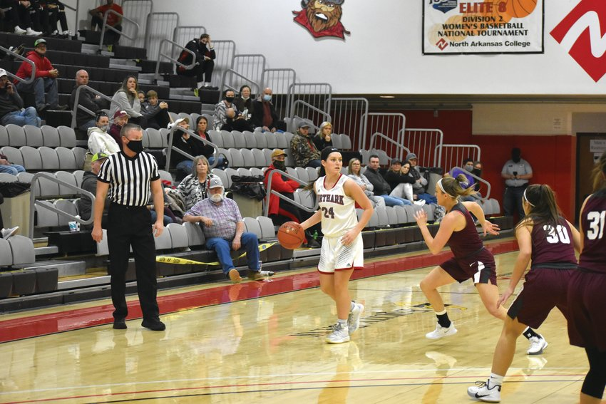 North Arkansas College's Baylea Smith looks for a teammate during action at Pioneer Pavilion. Smith averaged 15.9 points a game this season while hitting 47.1 of her 3-point shots. Those numbers helped her earn a first team All-Region II honor.