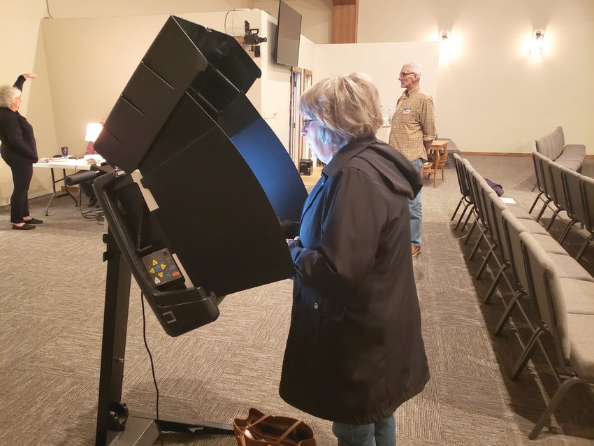 Virginia Nelson casts her ballot on election day at Woodland Baptist Church.