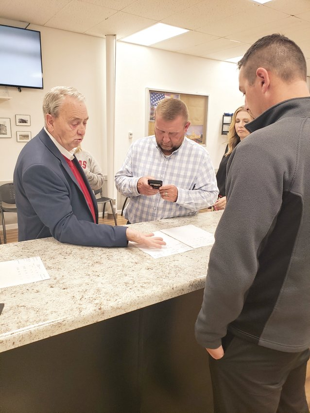 Harrison Mayor Jerry Jackson (from left), Parks director Chuck Eddington and chief financial officer Luke Feighert look over unofficial results on election day, Tuesday, May 11.