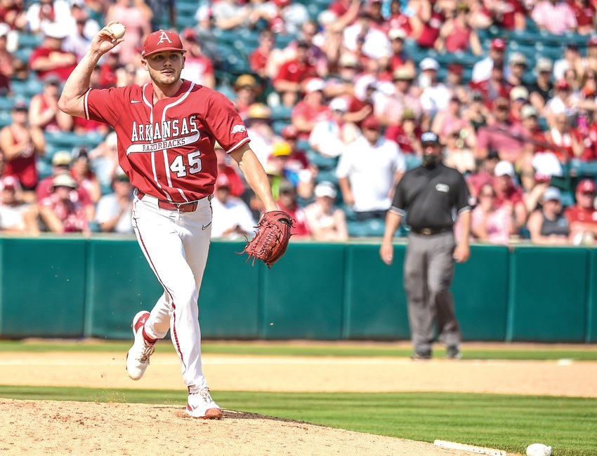 Arkansas pitcher Kevin Kopps attempts a pickoff against N.C. State in the Super Regionals at Baum-Walker Stadium this season. Kopps has won the Dick Howser Trophy and is a finalist for the Golden Spikes Award which goes to the nation's best baseball player.