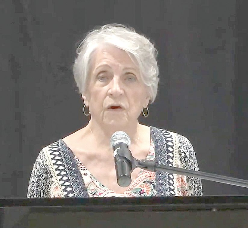 Former Arkansas Supreme Court Chief Justice and state Board of Apportionment coordinator Betty Dickey speaks to a crowd at a public hearing Tuesday night in Mountain Home.