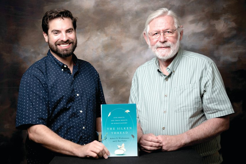 Ray Fisher, left, and Rob Wiedenmann wrote a book about the impact of five insects on human history. Fisher is a research scientist in entomology. Wiedenmann is a professor emeritus and former entomology department head. (UA System Division of Agriculture photo by Fred Miller) (UA System Division of Agriculture photo by Fred Miller)