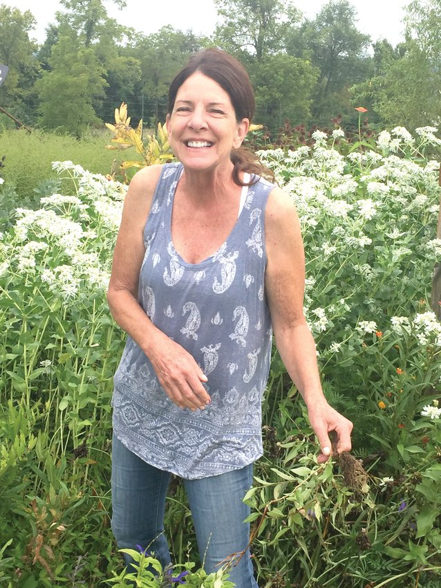 The newest member of the Master Gardeners, Kim Tillotson, enjoys working at the pollinator garden.