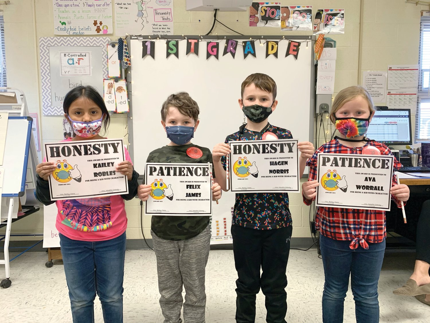 The Green Forest Kids with Character receiving awards are (from left) Kailey Robles, honesty; Felix James, patience; Hagen Norris, honesty and Ava Worrall, patience.